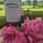 Antietam Creek Vineyards wine bottle and peonies
