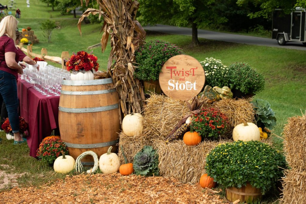 Tableau of autumn decorations and Twist & Stout signage