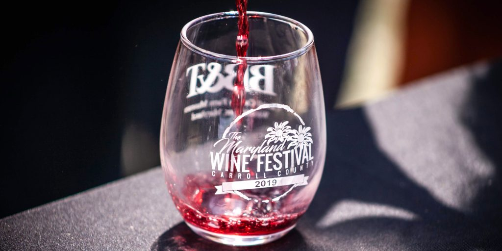 Red wine sample being poured into a glass.
